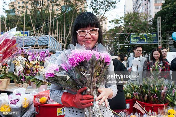 A vendor sets up a bouquet at the Flower Market set up for the Lunar New Year as China prepares for the Year of the Horse at Victoria Park on January...