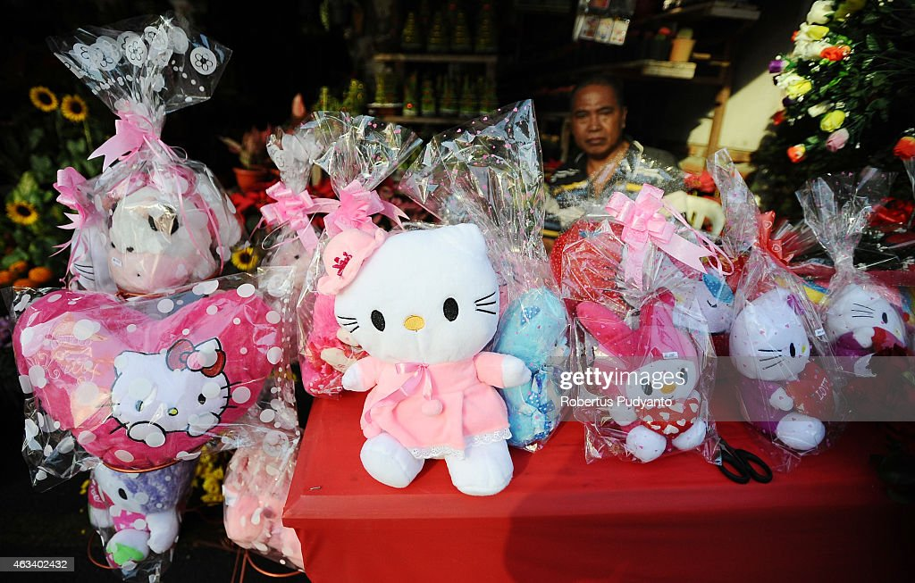 A vendor sets up Hello Kitty's toys during Valentines Day on February 14, 2015 in Surabaya, Indonesia. Roses, chocolates, teddy bears, toy hearts, candles, and cards are all part of the Valentines Day and orders increase significantly in the weeks leading up to the Valentines Day which celebrated on February 14th.