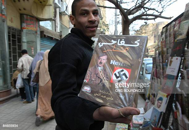 A vendor shows an Arabic translation of Adolf Hitler's Mein Kampf in the Egyptian capital Cairo on February 5 2009 One of the most wanted Nazi war...