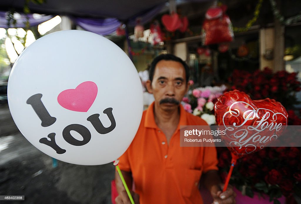 A vendor shows balloons during Valentines Day on February 14, 2015 in Surabaya, Indonesia. Roses, chocolates, teddy bears, toy hearts, candles, and cards are all part of the Valentines Day and orders increase significantly in the weeks leading up to the Valentines Day which celebrated on February 14th.