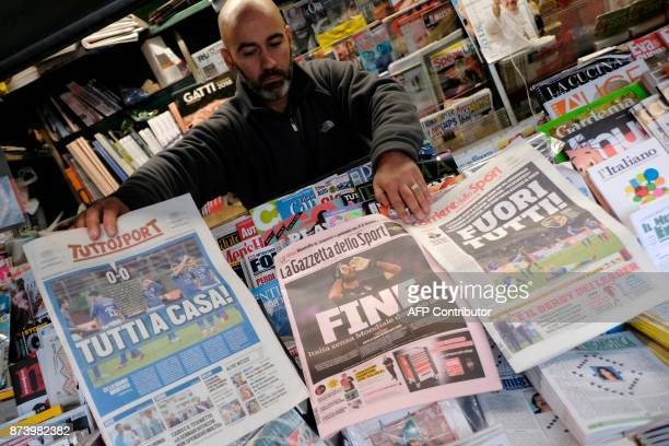 Vendor shows front pages of newspapers a day after the FIFA World Cup 2018 qualification football match between Italy and Sweden, on November 14,...