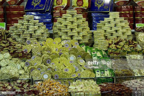 A vendor shows traditional sugar candy in the shape of a doll named âAroset El Moulidâ and candy horse at a street market ahead of Mawlid alNabi the...