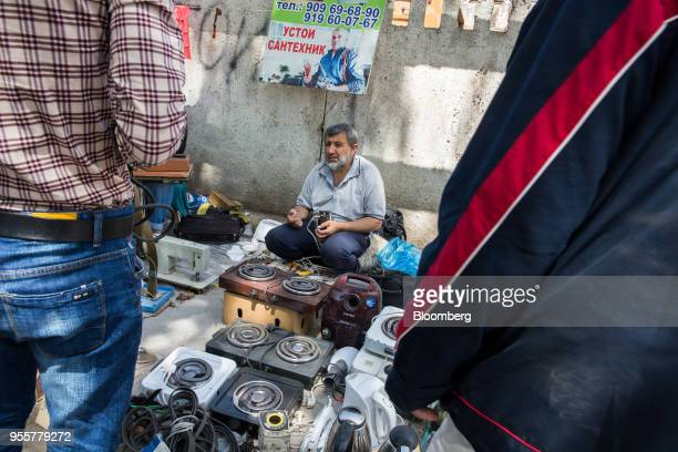 A vendor sits at his stall at a market in Dushanbe Tajikistan on Sunday April 22 2018 Flung into independence after the Soviet Union collapsed in...