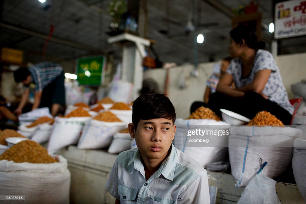 A vendor sits next dried shrimp in sacks on sale at Thirimingala Market in Yangon, Myanmar, on Monday, Oct. 12, 2015. Myanmar's government signed a cease-fire agreement with half of the nation's armed ethnic groups, a partial victory for President Thein Sein less than a month before an historic national election. Photographer: Brent Lewin/Bloomberg via Getty Images