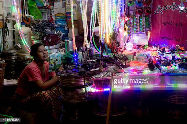 A vendor sits waiting for customers at a light store in Yangon Myanmar on Tuesday Oct 6 2015 Campaigning for Myanmar's Nov 8 general election begins...