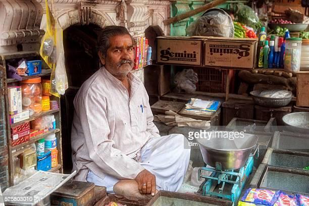 Vendor sitting at his street stall Bikaner, Rajasthan, India