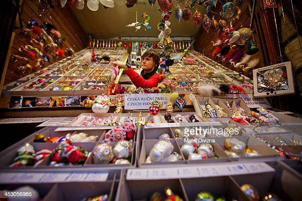A vendor sorts christmas decorations at the Christmas market at the Old Town Square on December 2 2013 in Prague Czech Republic Christmas markets...