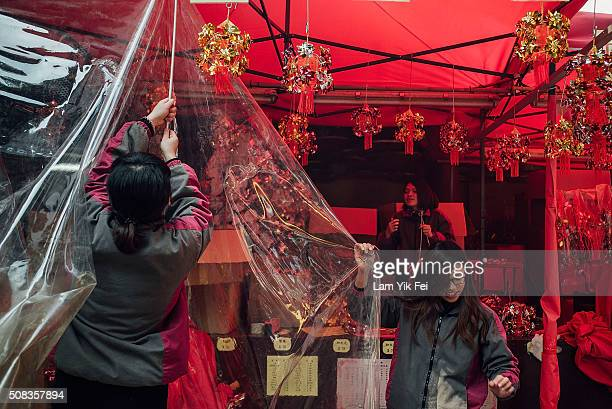 Vendor staffs prepare the stall to sell pinwheel as pinwheel is a symbol of getting rid of bad luck at Che Kung Temple on February 4 2016 in Hong...