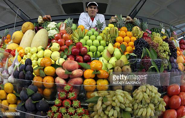 A vendor stands behind his fruit stand at the Dorogomilovsky Market during a 'slow food' farmers' festival in Moscow on September 25 2010 AFP PHOTO /...