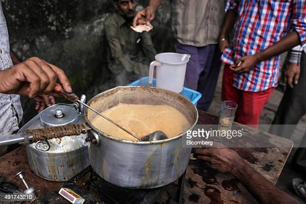 A vendor stirs chai while preparing the spiced tea at a roadside stall in Mumbai India on Friday Sept 25 2015 That sweet and milky tea concoction...