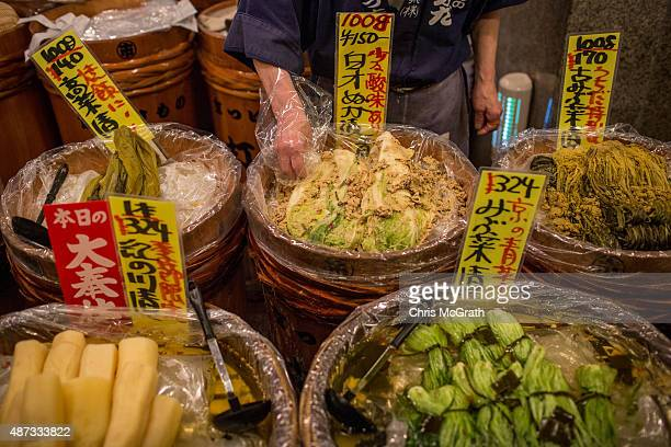 A vendor tends to vegeatables on sale at the famous Nishiki Food Market on September 6 2015 in Kyoto Japan The famous city of Kyoto is going through...