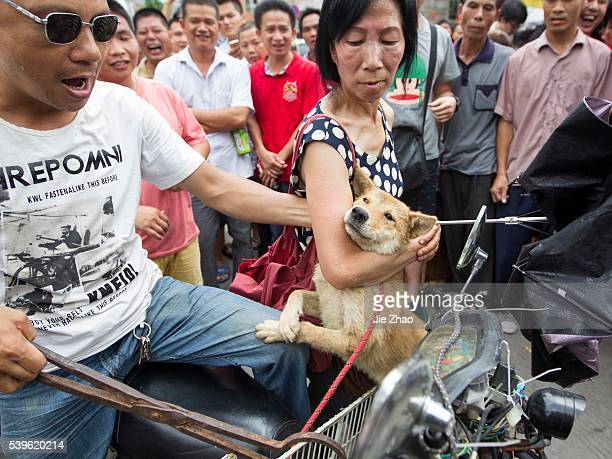 A vendor threatens that he will kill the dogs if the activities do not pay the price at a free market ahead of the Yulin Dog Eating Festival in Yulin...