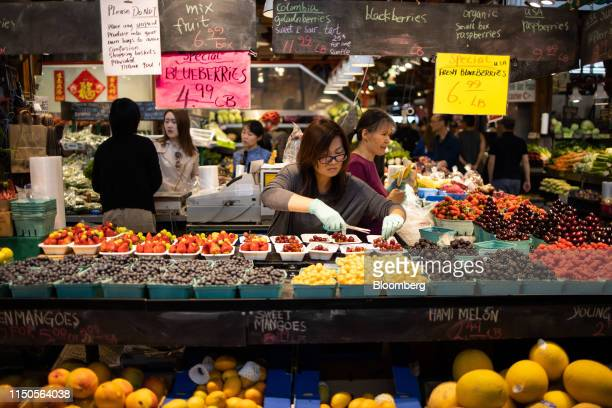 A vendor trims grapes at the Granville Island Public Market in Vancouver British Columbia Canada on Sunday June 2 2019 Statistics Canada is scheduled...
