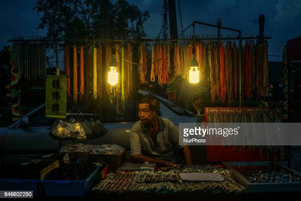 A vendor wait his customer near the Chinese temple during the Hungry Ghost Festival in Teluk Pulai Klang Malaysia on September 13 2017