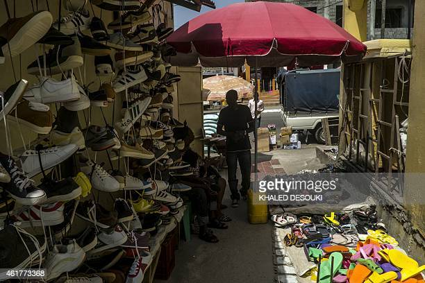 A vendor waits for customers a market in Bata on January 19 2015 as Equatorial Guinea hosts the 2015 African Cup of Nations football tournament AFP...