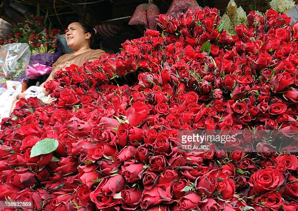 A vendor waits for customers at a flower market on Valentine's Day in Manila on February 14 2012 Valentine's Day is observed on February 14 honoring...