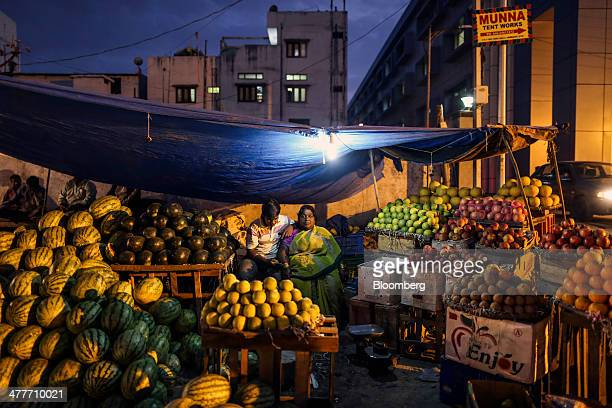 A vendor waits for customers at a fruit stall near Moazzam Jahi Market in Hyderabad India on Monday March 10 2014 India's consumer price index...