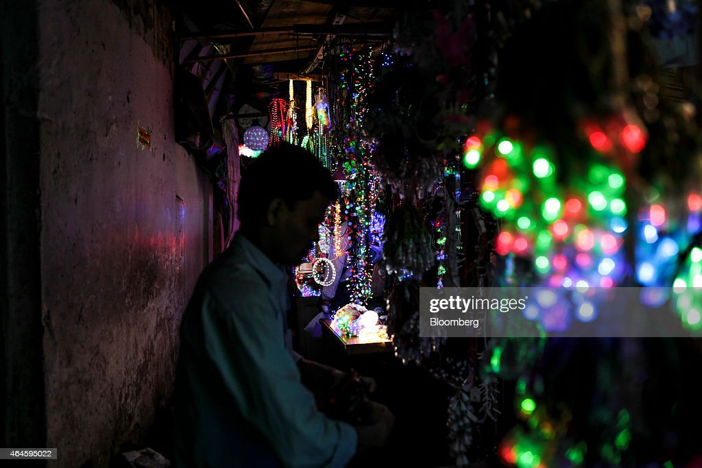 A vendor waits for customers at a lighting stall in the Null Bazar market area in Mumbai, India, on Thursday, Feb. 26, 2015. India's Finance Minister Arun Jaitley will present this year's budget on February 28. Speculation that Prime Minister Narendra Modi's policies will boost economic growth has propelled India's Sensex to the world's third-biggest gain among major markets during the past 12 months. Photographer: Dhiraj Singh/Bloomberg via Getty Images