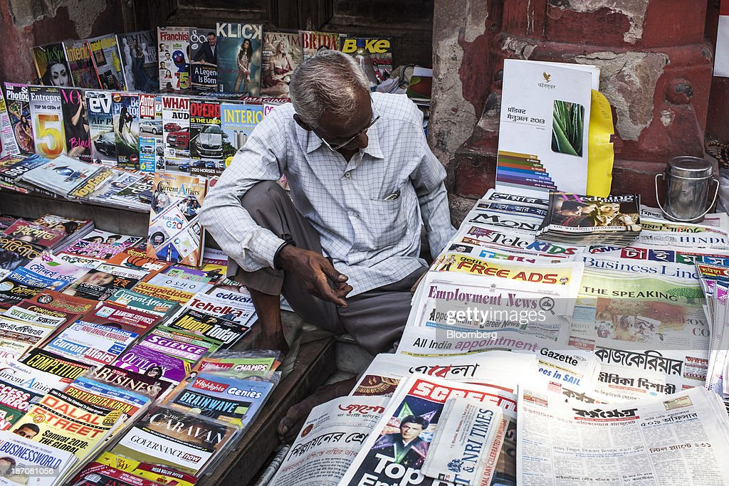 A vendor waits for customers at a newspaper stall in Kolkata, West Bengal, India, on Friday, Nov. 1, 2013. Indian stocks fell for the first time in six days, led by technology and consumer companies, after benchmark indexes climbed to records in a holiday trading session on Nov. 3. Photographer: Sanjit Das/Bloomberg via Getty Images