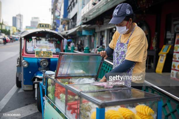 A vendor wearing a protective face mask stands at a fruit stall in Bangkok Thailand on Wednesday Sept 2 2020 Thailand has reported zero...
