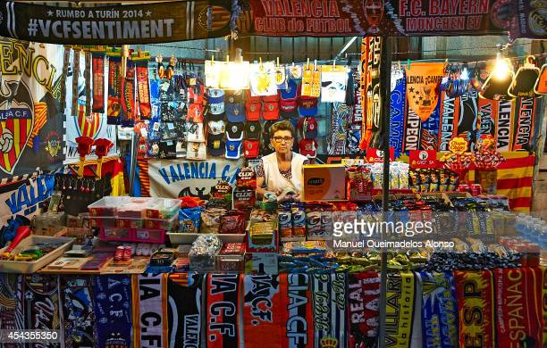 A vendor works at a merchandise stall prior to the La Liga match between Valencia CF and Malaga CF at Estadi de Mestalla on August 29 2014 in...