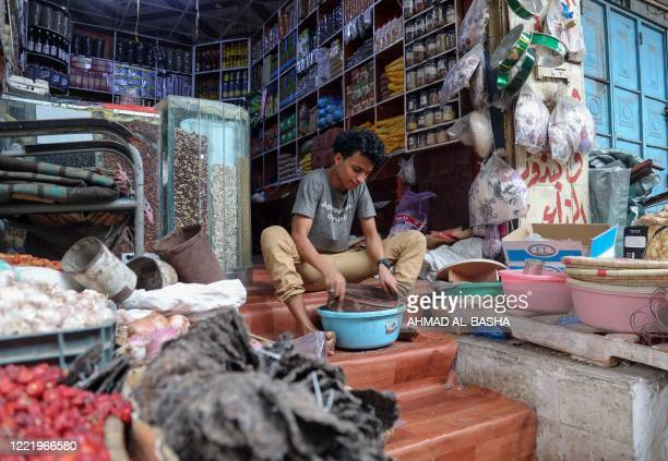 A vendor works at a shop selling medicinal plants and spices at a market in Yemen's third city of Taez on June 15 2020 As medicines run short and...
