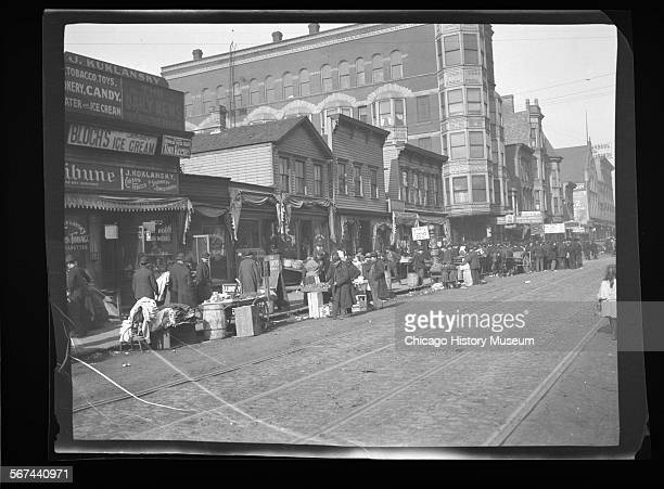 Vendors along west side of Jefferson Street near Maxwell Street Chicago Illinois 1906