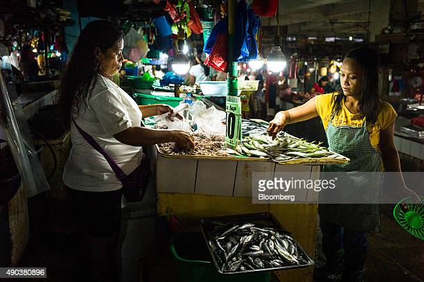 Vendors arrange fish for sale at the Old Market in Puerto Princesa, Palawan, the Philippines on Thursday, June 25, 2015. The U.S. Has also sought to...