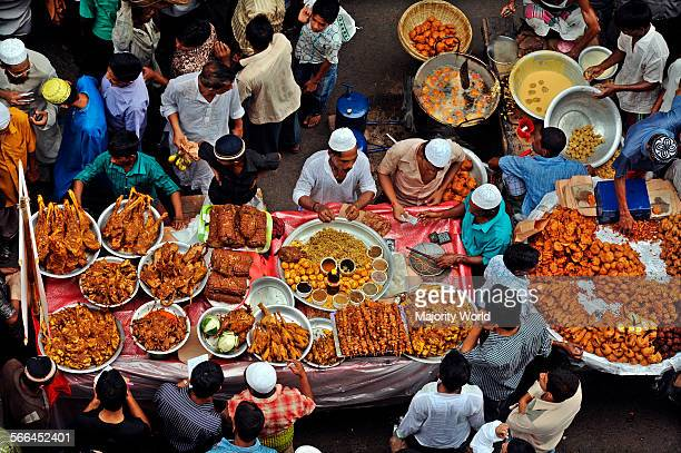 Vendors at Chawk Bazaar Old Dhaka sell food items for Iftar the evening meal for breaking fast during Ramadan the Muslim holy month of fasting Dhaka...