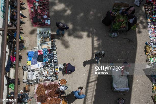 Vendors attend to stalls at a market in Dushanbe Tajikistan on Sunday April 22 2018 Flung into independence after the Soviet Union collapsed in 1991...