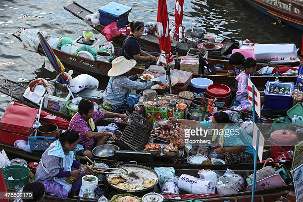 Vendors cook food in their boats at the Amphawa Floating Market in Aphawa Samut Songkhram Province Thailand on Saturday May 30 2015 The Bank of...