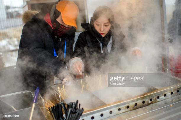 Vendors cook hot food at PyeongChang Olympic Stadium on February 11 2018 in Pyeongchanggun South Korea Yesterday Kim Yojong the sister of North...