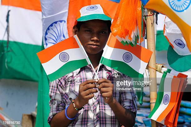 Vendors display tricolors for sale on a roadside shop on the eve of Independence Day on Wednesday, August 14, 2013 in Noida, India. Security...