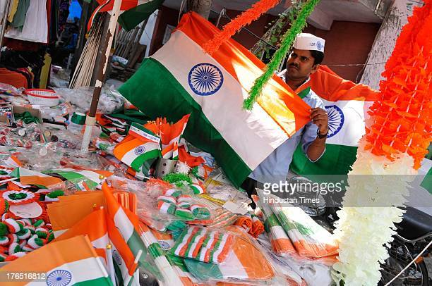 Vendors display tricolors for sale on a roadside shop on the eve of Independence Day on Wednesday August 14 2013 in Noida India Security personnel...