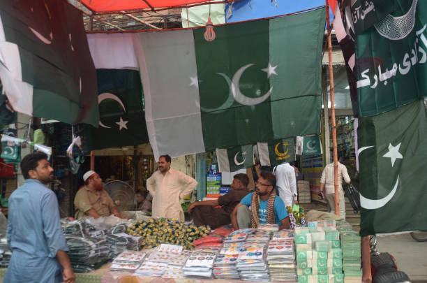 Vendors displaying national flags badges and any related stuff to attract the customers in connection with the upcoming Independence Day in Lahore on.