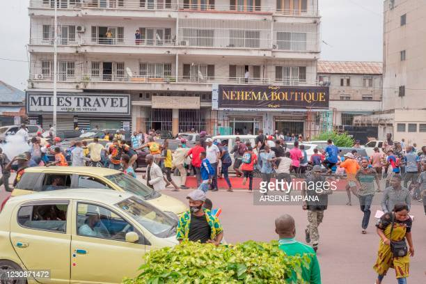Vendors from the central market disperse after police officers fired teargas while they were marching against the decision of the city governor,...