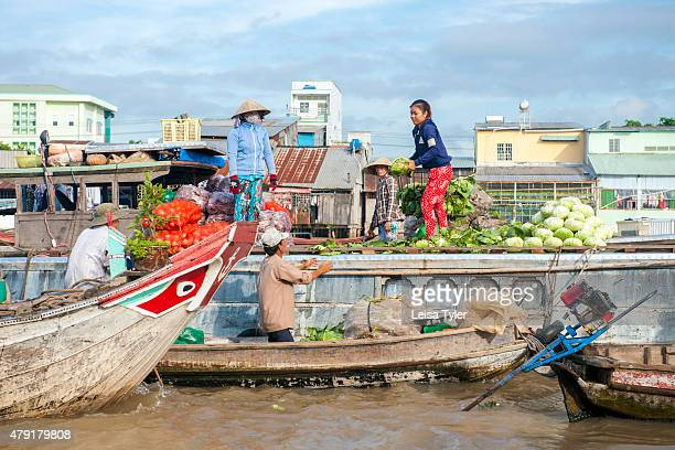 Vendors hawk fruits and vegetables at Cai Rang, the biggest floating market in the Mekong Delta. The market, 6km from Can Tho, at 1.5million...