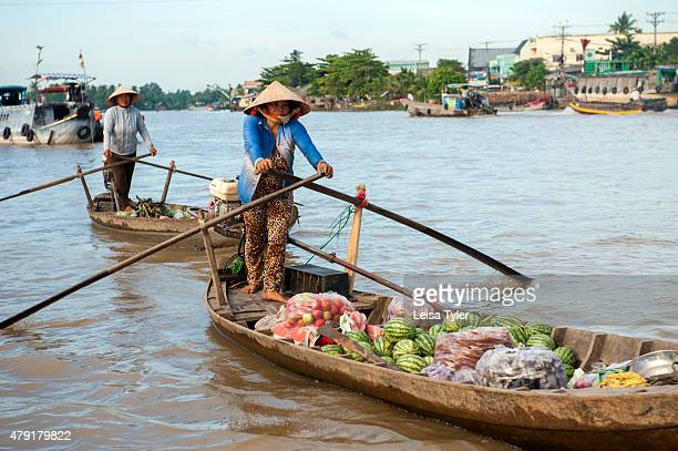 Vendors hawk fruits and vegetables at Cai Rang the biggest floating market in the Mekong Delta The market 6km from Can Tho at 15million inhabitants...