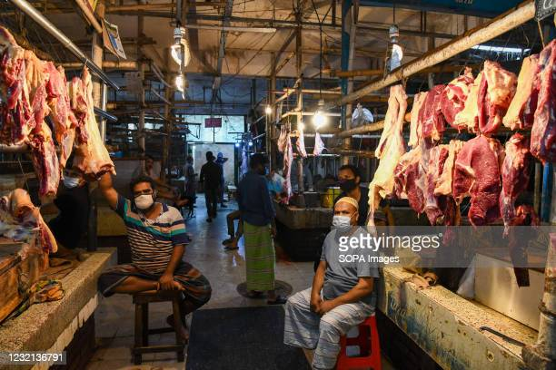 Vendors in the Mohakhali meat market are seen relaxing in a market that is quiet due to the lockdown in Dhaka.