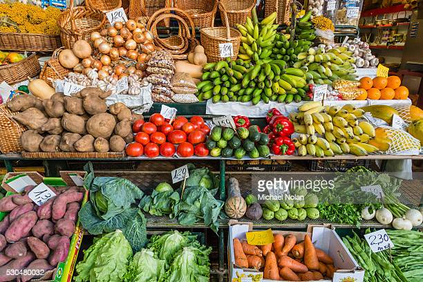 Vendors inside the Funchal Market, where fresh produce and fish are sold in the capital city of Funchal, Madeira, Portugal, Europe