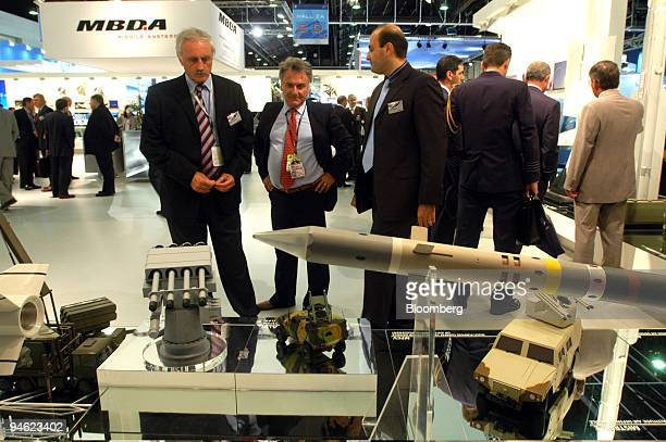 Vendors look at weapons systems on display at the MBDA stand at the 47th International Paris Air Show in Le Bourget France on Monday June 18 2007...