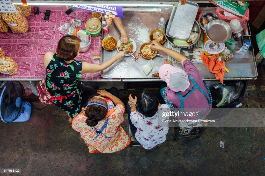Vendors lunch at Warorot market, Chiang Mai : Stock Photo