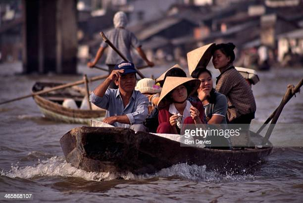 Vendors on their way to Phung Hiep, one of the world's largest floating markets situated at the confluence of seven canals in the Mekong Delta in...