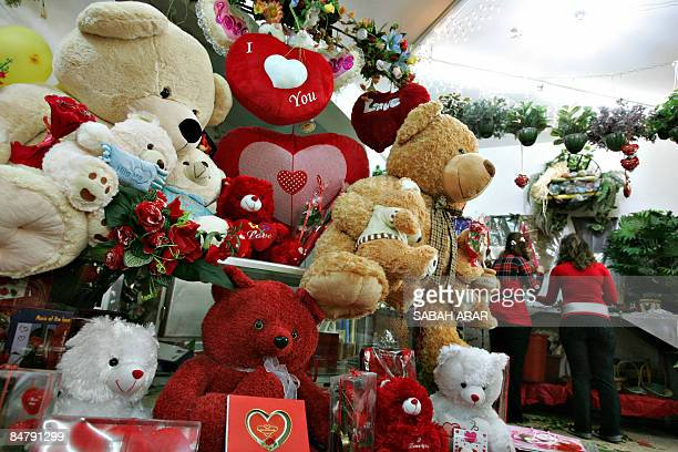Vendors prepare bouquets of flowers for Valentine's Day at a store in central Baghdad on February 14 2009 Red roses are selling at a premium for...