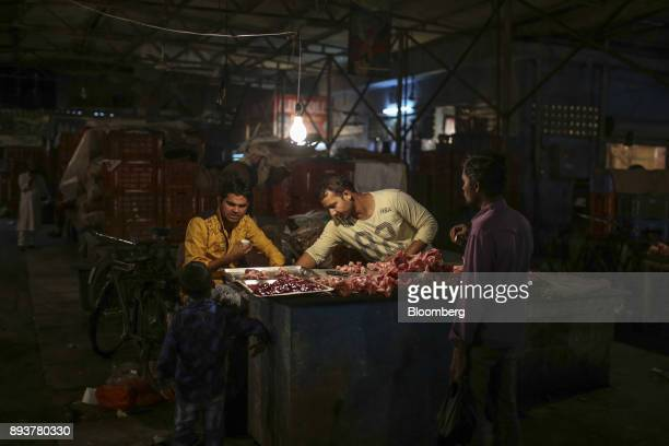 Vendors prepare chicken at a stall in Mumbai India on Friday Dec 15 2017 India's inflation surged past the central bank's target bolstering a view...