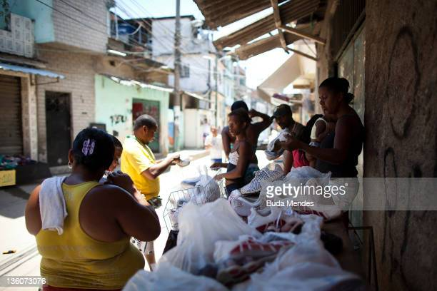 Vendors sale tennis shoes at Complexo do Alemao one year after the pacification carried out by the Brazilian security forces on December 21 2011 in...