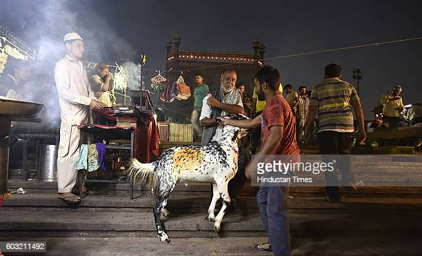 Vendors seen with their goats for sale at a livestock market ahead of the sacrificial Eid alAdha festival at Jama Masjid on September 12 2016 in New...