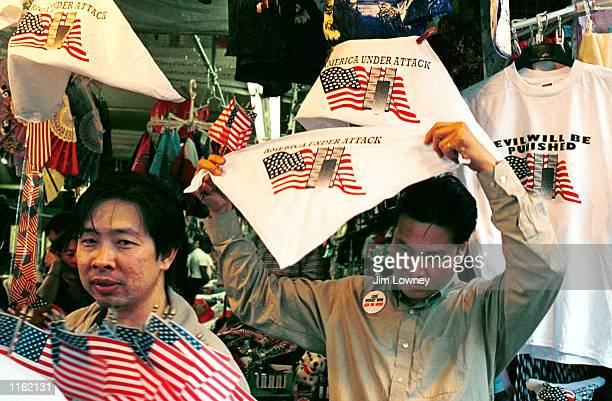 Vendors sell American flags and pro-American clothing September 16, 2001 on New York City's Canal Street, the southernmost street yet open to the...
