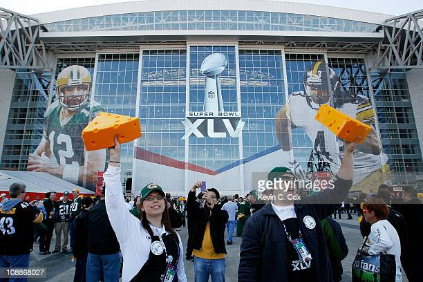 Vendors sell cheese head hats for Green Bay Packers fans before they play against the Pittsburgh Steelers in Super Bowl XLV at Cowboys Stadium on...
