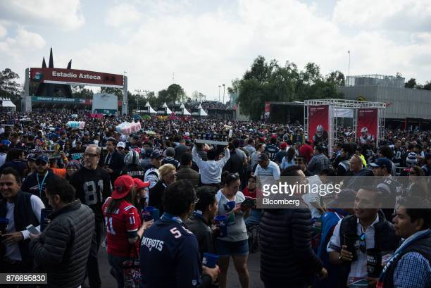 Vendors sell drinks and cotton candy as attendees enter Estadio Azteca before the start of a National Football League game between the Oakland...